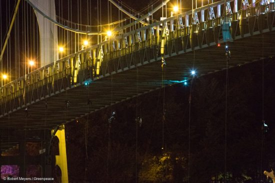 Activists hang under the St. Johns Bridge in Portland, Oregon, In an attempt to block the Shell leased icebreaker, MSV Fennica July 29, 2015. The climbers are currently preventing the ship from passing underneath the bridge on its way to meet Shell's drilling fleet. The climbers have enough supplies to last for several days. According to the latest federal permit, the Fennica must be at Shell's drill site before Shell can reapply for federal approval to drill deep enough for oil in the Chukchi Sea.