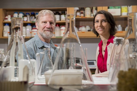 An environmental portrait of distinguished research professor James T. Hollibaugh, left, and researcher Sylvia Schaefer of Marine Sciences in Hollibaugh's lab inside the Marine Sciences Building.
