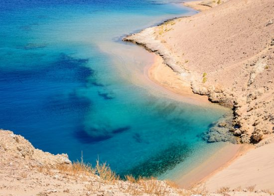 In the picture a beautiful turquoise lagoon with rocky beaches located in Egypt in the Red Sea